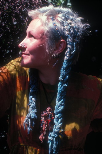 New Age Traveller with blue extensions and tie-dye clothing, London 1980's © Ted Polhemus/PYMCA
