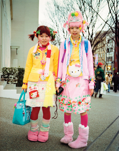 Two young girls dressed in Hello Kitty merchandise, Tokyo, Japan, 2000. ©Ben Knight/PYMCA